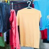 airing dry shirts on plastic hangers