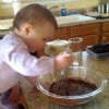 child stirring pudding