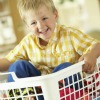 boy in laundry basket