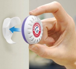 placing Munchkin Arm & Hammer nursery freshener in bracket