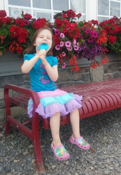 little girl eating a popsicle
