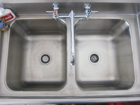 before and after of stainless steel sink cleaned with Bar Keepers Friend