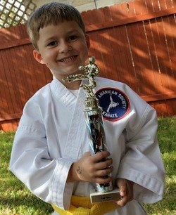 boy in karate uniform